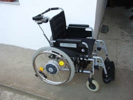 E-Fix electric wheelchair - control for patient or accompanying person possible.