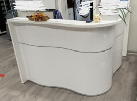 Reception counter OCEAN, high gloss front white, wave-shaped, 181x159x110 cm, as good as new